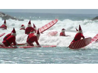 """Surfin' Santas"" ad by Aldi"