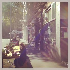 Kinkfolk - Table outside the cafè on a sunny day
