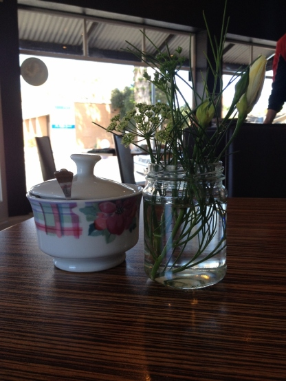View of the Sabai Cafe', outside Glenelg, through plants & sugar (Photocredit: lavaleandherworld.wordpress.com)