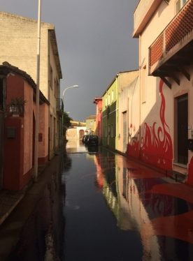 """""""Murales"""" and light playing with the rain, San Sperate (Photocredit: http://www.lavaleandherworld.wordpress.com)"""